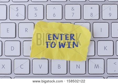 Enter to win./ Enter to win card with information on the keyboard