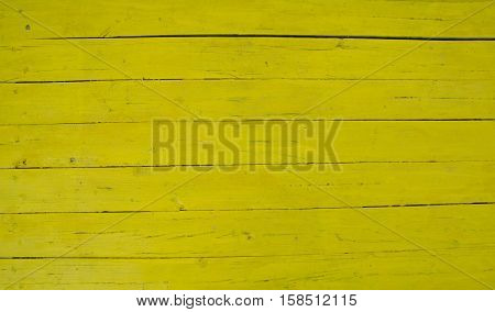 Yellow wooden plank table top showing individual planks
