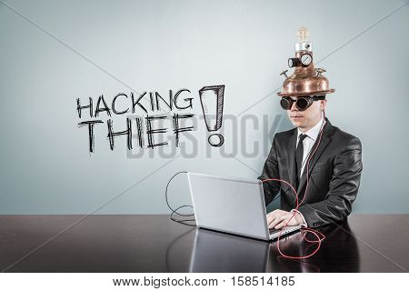 Hacking thief text with vintage businessman using laptop at office