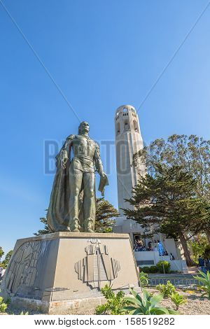 The Coit Tower and a statue of Christopher Columbus in the North Beach neighborhood on Telegraph Hill, in a sunny day, San Francisco, California, United States.
