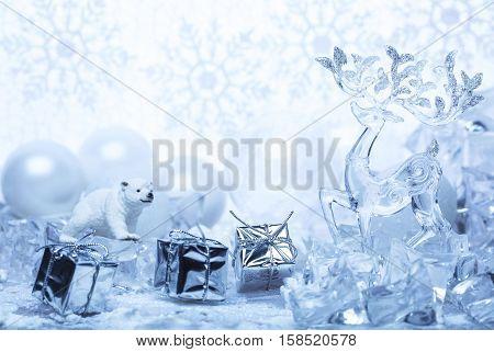 Christmas tale. Reindeer, polar bear on a background of snow and ice.
