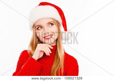 Portrait Of Minded Woman In Santa Hat Dreaming About Gifts