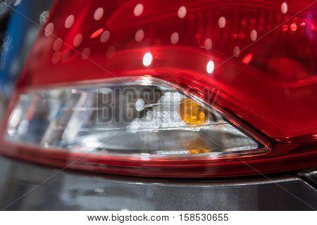 Closeup photograph of rear light of car.