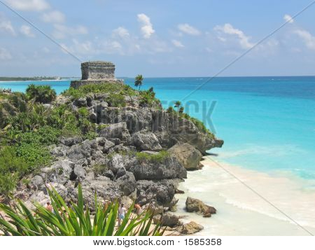 Tropical Carabian Beach With A Maya Temple Of A Top Of A Rock Cliff, Tulum, Mexico