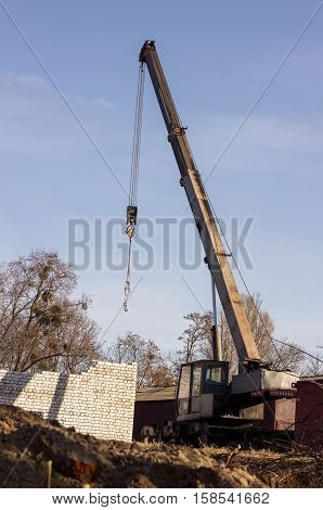 construction machine with a crane helps in the construction of buildings lifts heavy loads