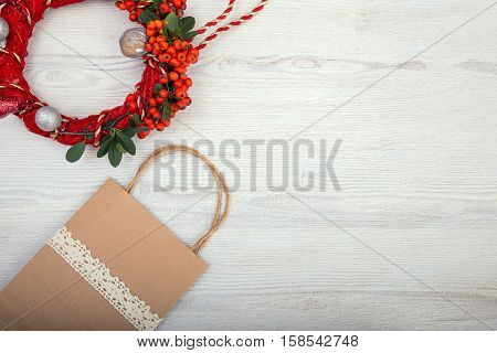 Christmas background on wooden table and copy space shopping bag