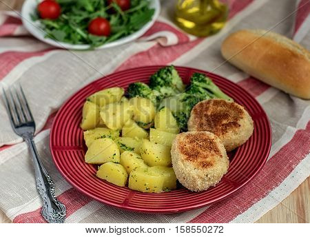 Chicken meatballs stuffed with mozzarella cheese served with vegetables