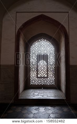 DELHI, INDIA - FEBRUARY 13 : Intricate carving of stone window grill at Humayun's Tomb, built by Hamida Banu Begun in 1565-72, Delhi, India on February 13, 2016.