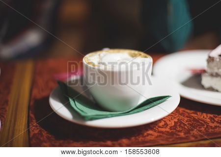 Flat white cup of coffee latte, closeup, shallow dof, selective focus