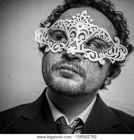 Fraud, Sensual and mysterious businessman with white venetian mask