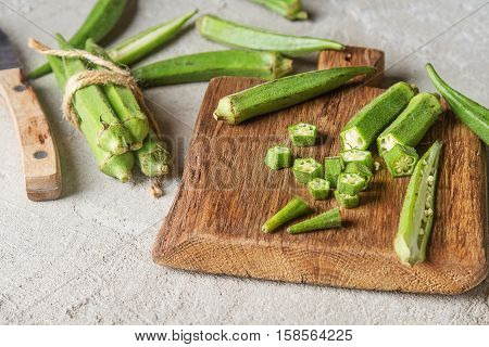 Lady Fingers Or Okra Over Concrete Table Background.