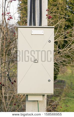 Electrical shield box on an electricity pole.