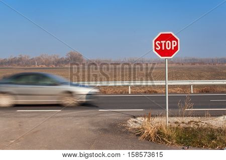 Stop Sign at Crossroads. Roads in the Slovak countryside. Exit onto the main road. Main road. Dangerous road. Traffic signs stop.