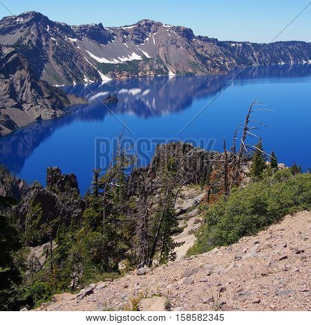The rugged crater at Crater Lake on a sunny afternoon.