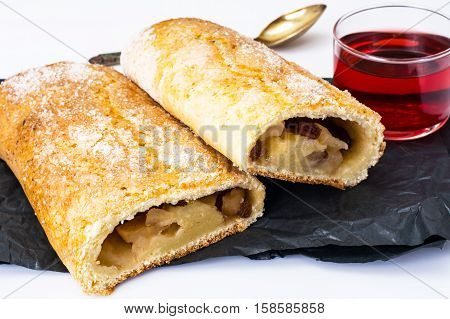 Apple strudel with cottage cheese and raisins. Studio Photo
