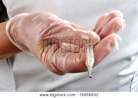 Medical Staff Keeps Thermometer With Disposable Glove