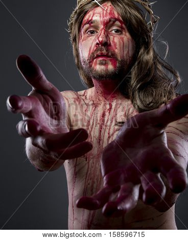 Hands, Jesus christ, jesus of nazareth with the crown of thorns and blood for his body as penance before the crucifixion