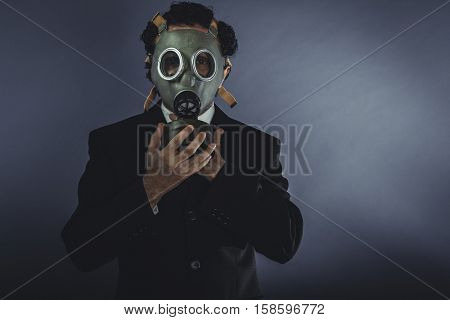Apocalypse Businessman with protective mask, concept business dangerous for the environment or for society