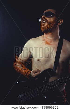 Metal, Rock star with electric guitar and concert hall smoke environment