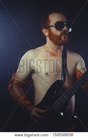Musical, Rock star with electric guitar and concert hall smoke environment
