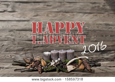 Merry Christmas decoration advent 2016 with burning grey candle Blurred background text message english 1st