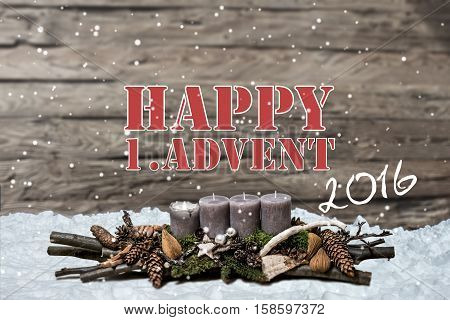 Merry Christmas decoration advent 2016 with burning grey candle Blurred background snow text message english 1st