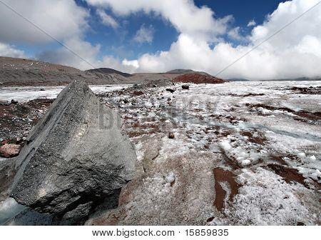 Stone on the glacier moraine in Caucasus mountains