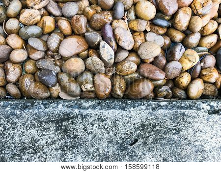 Abstract Background with Round Pebble Stones roadside