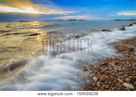 beautiful sea scape and sun set sky by long exposure photography process