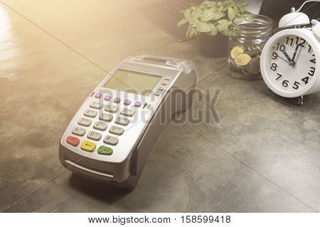Credit Card Terminal Or Edc On Cashier Table In The Store, Clock,coins In The Bottle, Credit Cards A