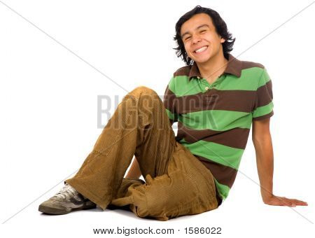 Casual Guy On The Floor With A Big Smile