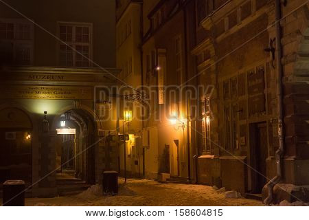 POLAND GDANSK - DECEMBER 30 2014: Historical buildings on the Long Market (Dlugi Targ) street at night. Gdansk is a Polish city on the Baltic coast and popular center of tourism.