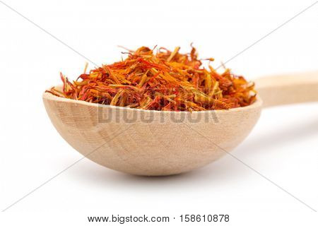 saffron spice in wooden spoon isolation white background