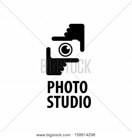 logo camera in the hands of the photographer