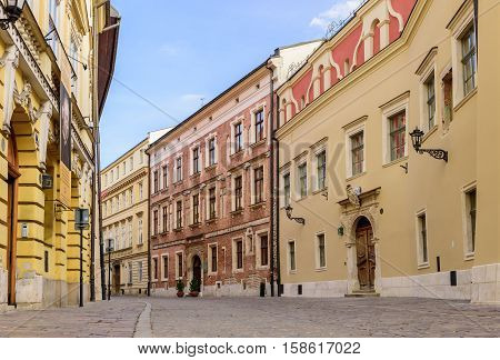 Krakow, Poland - November 5, 2016: pedestrian street in the old town with beautiful ancient houses.