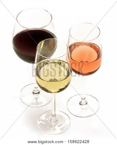 Three glasses of wine: white, rose, and red, on white background