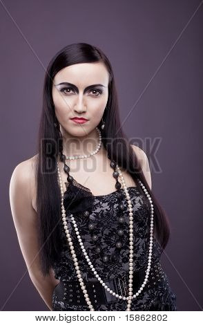 relaxed woman with long hair and pearl beads