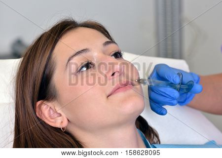 Plastic surgery concept. Hyaluronic acid injection in a medical environment