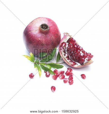 Pomegranate with seeds on a white background