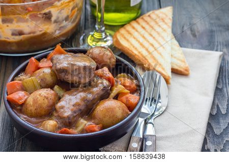 Hearty beef stew with carrot celery shallot and potato horizontal copy space