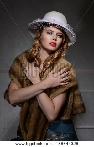 woman posing in 1940s style portrait with dark background