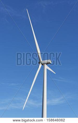 Wind Turbine Close Up Against A Blue Sky
