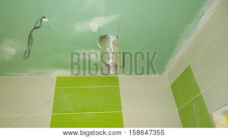 Construction work in the apartment installation of tiles on the wall and plaster ceiling Czech Republic