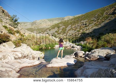Sexy Woman On A Rock Watching River
