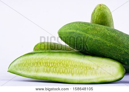 fresh green cucumber and slice of cucumber on white background healthy vegetable food isolated