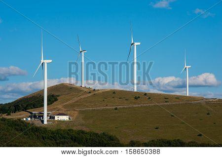 Eco power. Renewable energy. Wind turbines generating electricity.