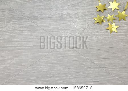 Five copper-colored stars on top of a gray background