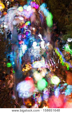 ATLANTA, GA - SEPTEMBER 2016:  Motion blur shows hundreds of people walking with colorful lanterns at night along the Beltline in the annual Atlanta Lantern Parade in the Old Fourth Ward in Atlanta GA on September 10 2016.