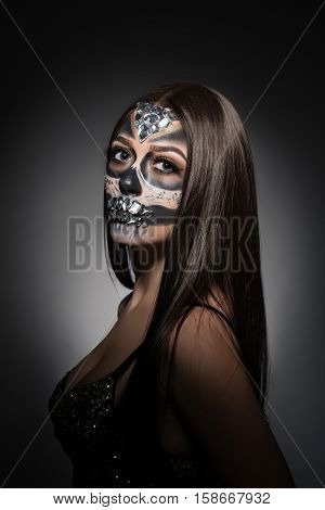 Santa Muerte. Image of pretty young woman with face art