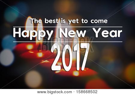 New Year Inspirational Greeting - The Best Is Yet To Come Happy New Year 2017. Bokeh And Red Candle